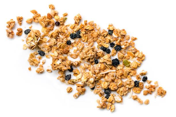 muesli or granola scattered on white top view - granola imagens e fotografias de stock
