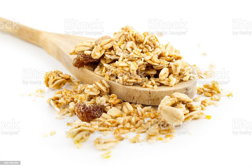 Muesli with dried fruits in wooden scoop stock photo