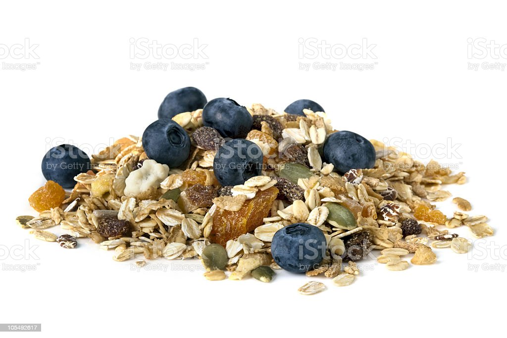 Muesli with fruit and blueberries against a white background stock photo