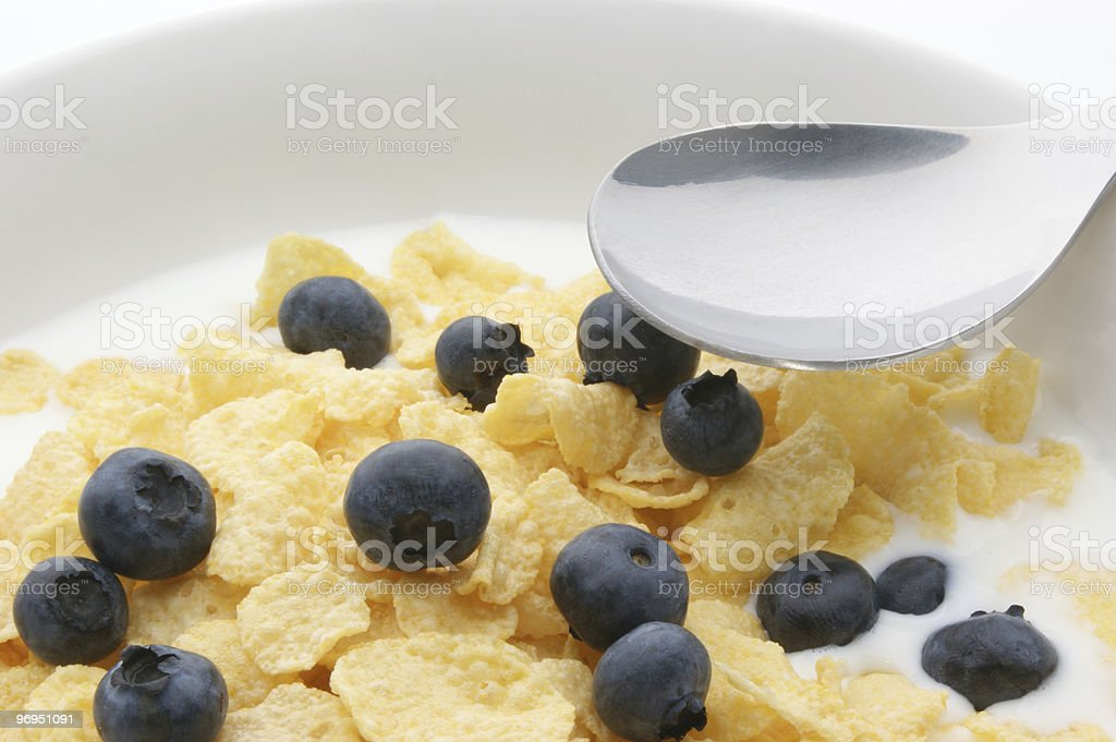 Muesli with milk and blueberries royalty-free stock photo