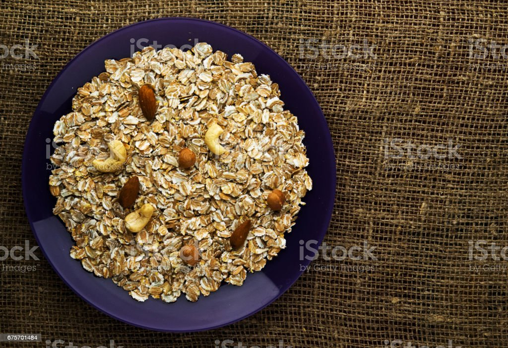 muesli with nuts hazelnuts, cashews. muesli on a wooden table. muesli top view. healthy food . royalty-free stock photo