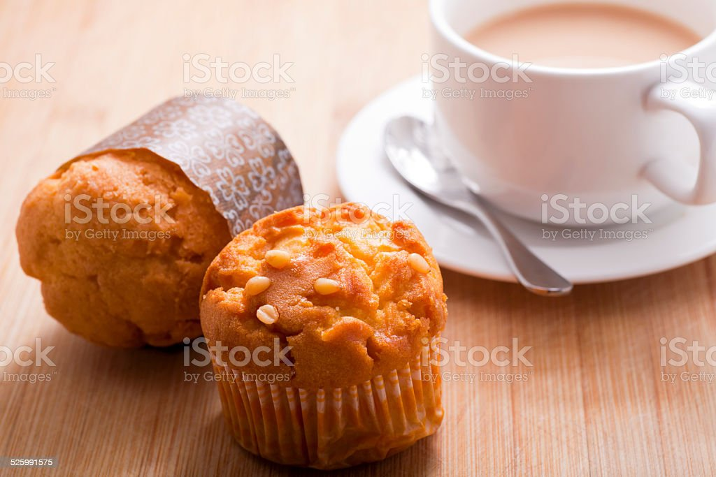 muffin and cup of coffee stock photo
