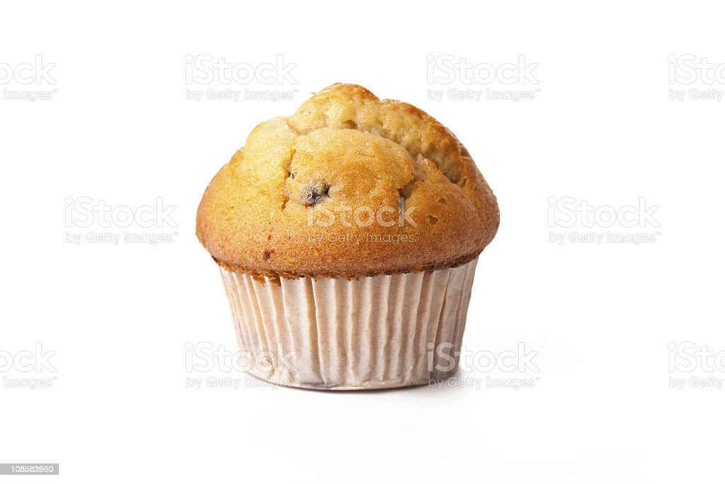 Muffin in paper baking cup isolated on white background