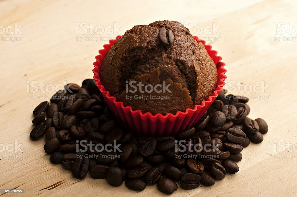 Muffin on a bed of coffee beans royalty-free stock photo