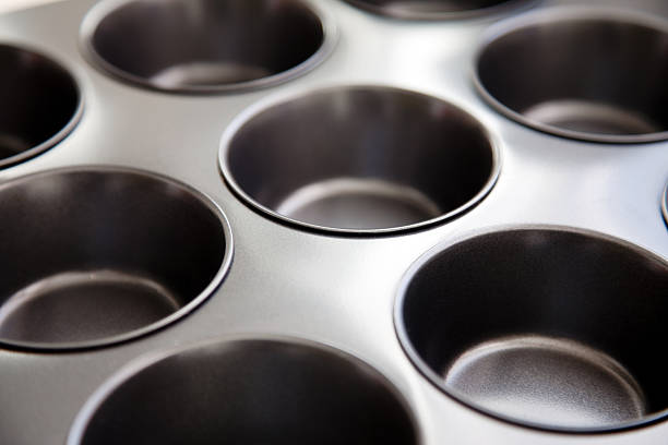 Muffin tray  muffin tin stock pictures, royalty-free photos & images