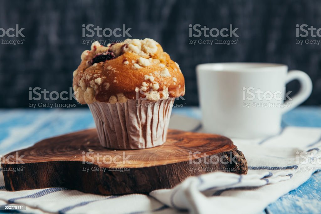 Muffin with berry on wooden table stock photo