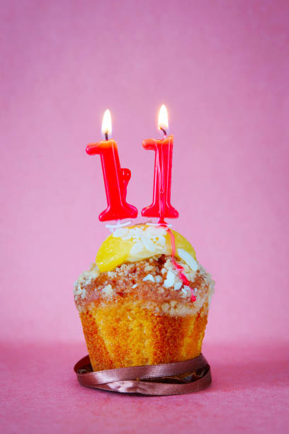 Top Birthday Cake With Burning Candle Number 11 Pictures Images And Stock Photos