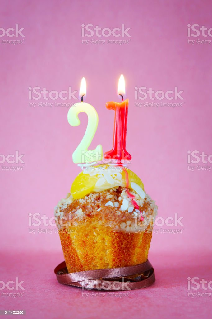Muffin With Burning Birthday Candles As Number Twenty One