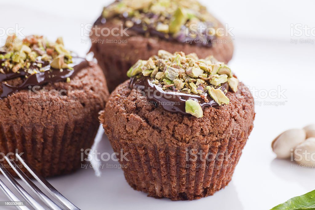 Muffin with chocolate and pistachios royalty-free stock photo