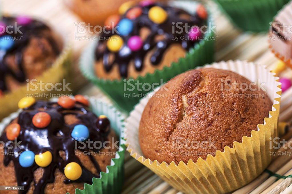 Muffin with chocolate glaze and smarties royalty-free stock photo