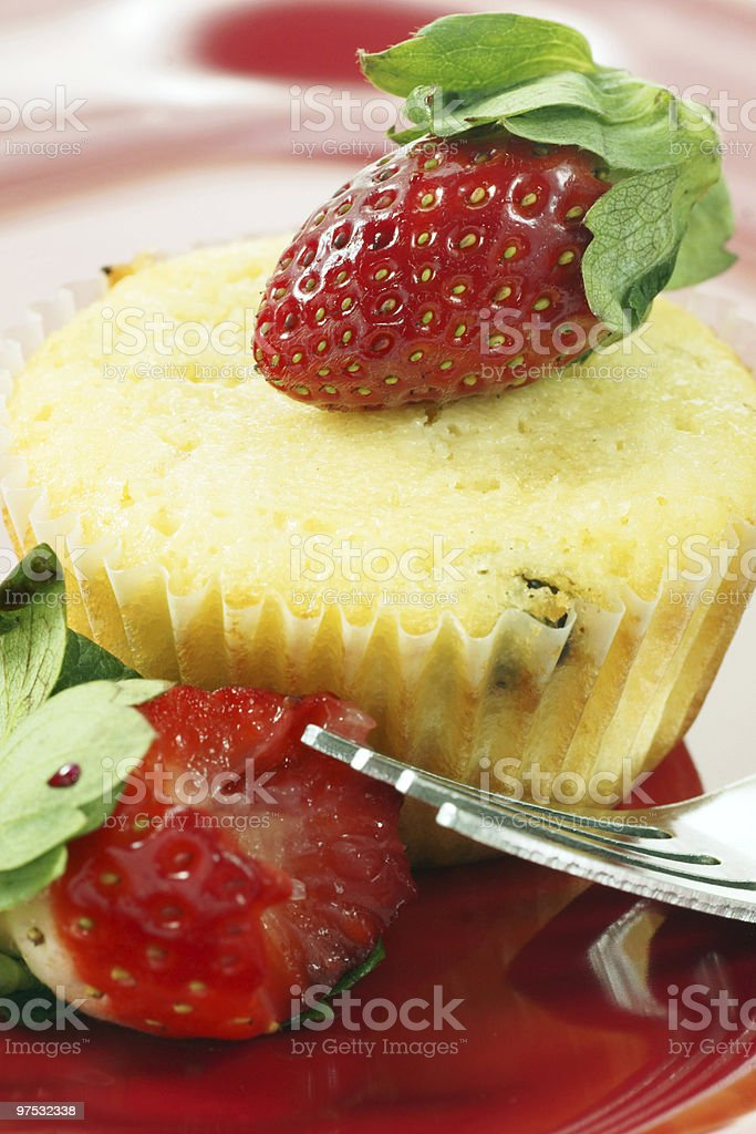 muffin with strawberry topping on red plate royalty-free stock photo