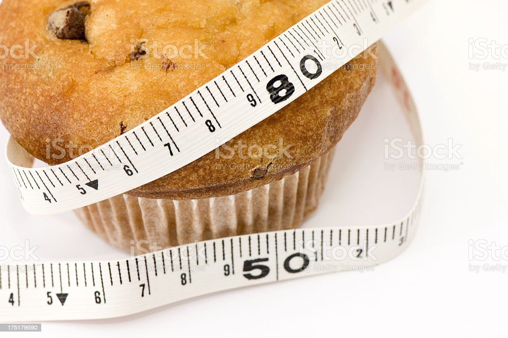Muffin with tape measure royalty-free stock photo