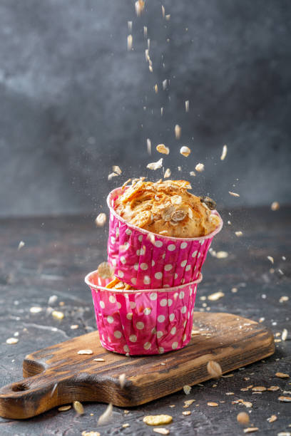 Muffins with pears and muesli in pink paper forms. stock photo