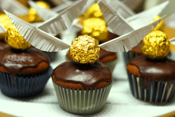 Muffins with snitch (Harry Potter Theme) decoration. stock photo