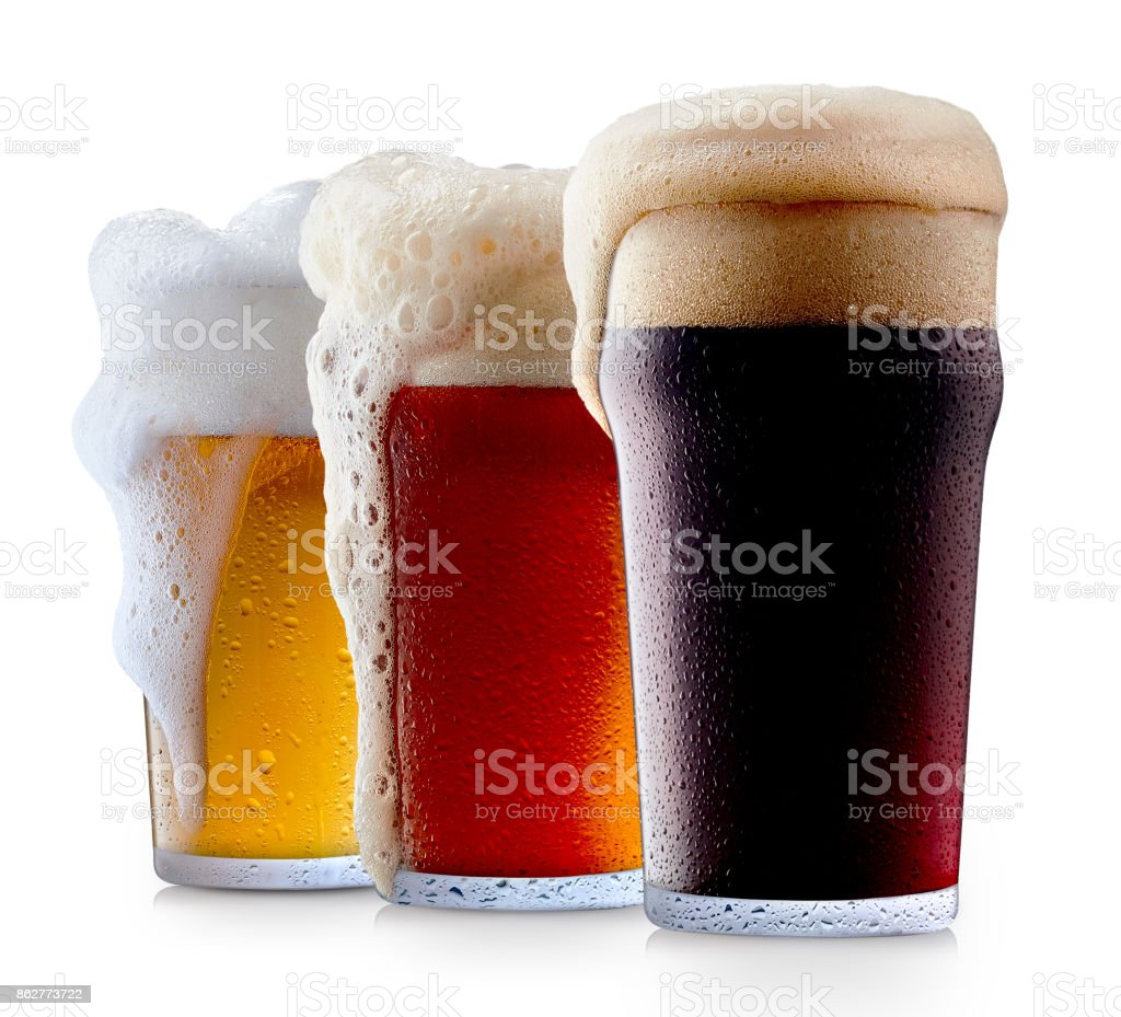Mug collection of frosty beer with foam stock photo