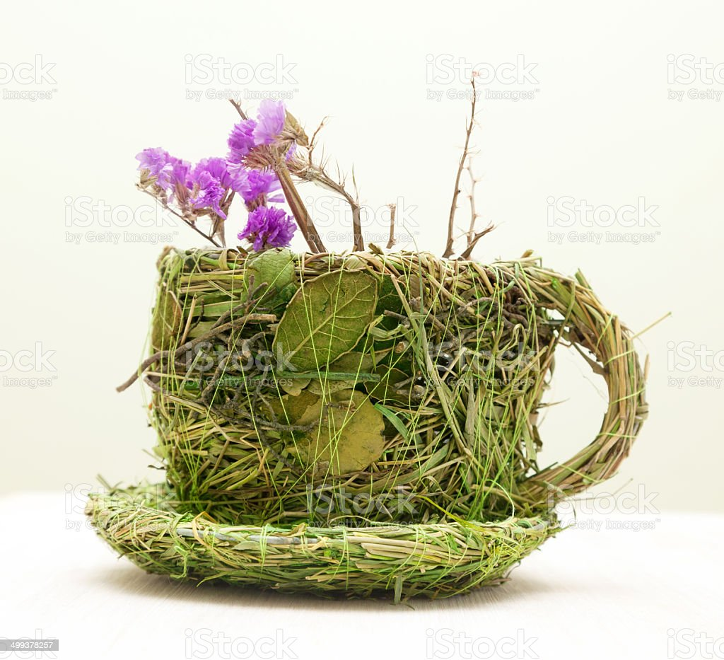 mug decorated with grass and leaves royalty-free stock photo