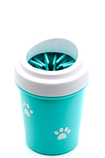 A mug for cleaning the pet's paws with a gentle soft silicone brush on the inside, filled with soap and water.