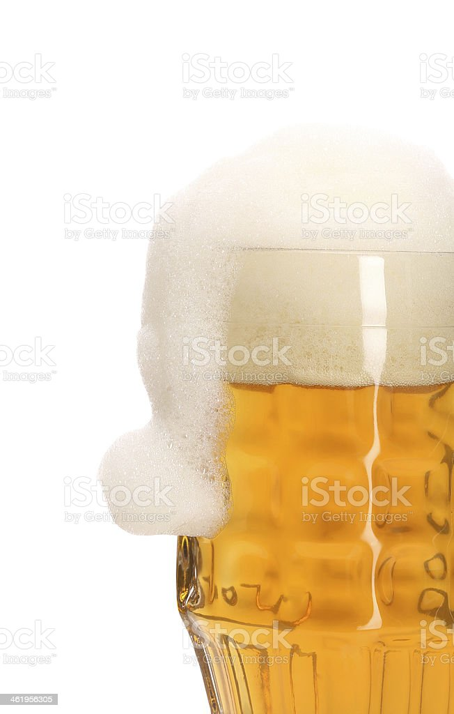 Mug full with beer and foam as santa's hat. stock photo