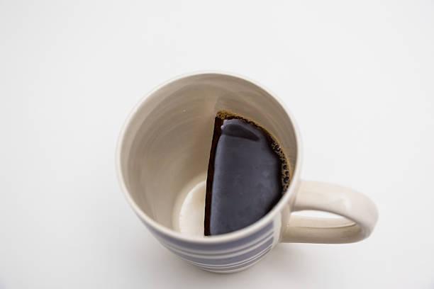 Mug half full of coffee stock photo