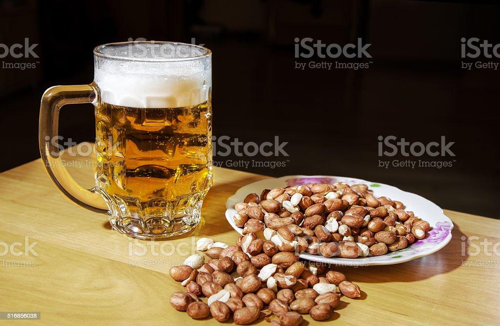 mug of beer and peanuts stock photo