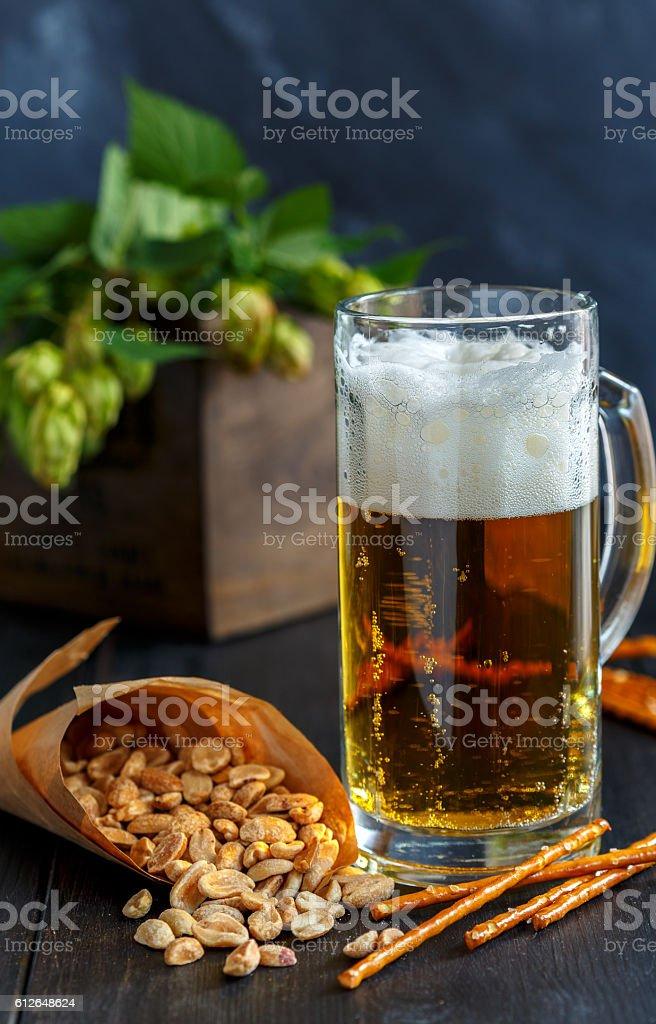 Mug of beer, peanuts and straws. stock photo