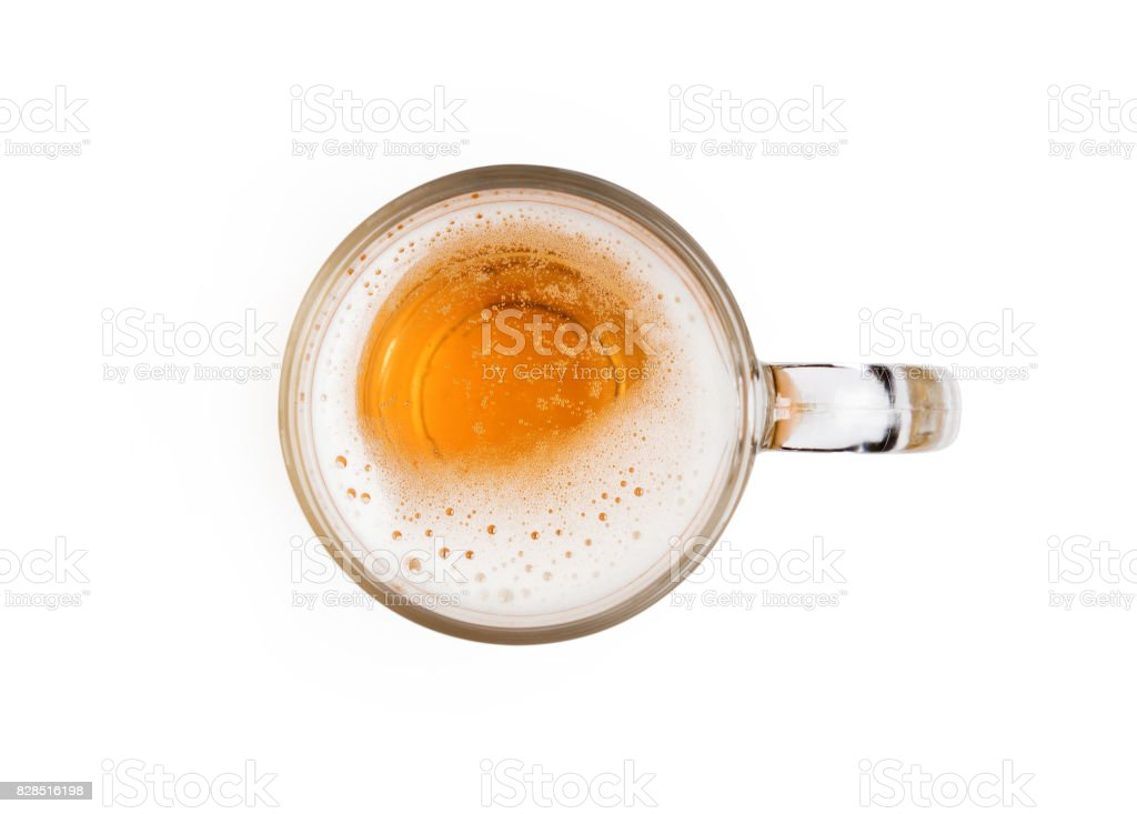 Mug of beer with bubble on glass isolated on white background top view stock photo