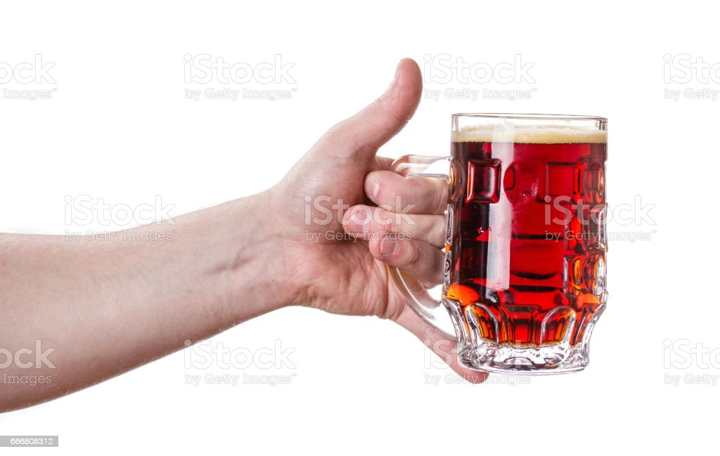 A mug of black beer in his hand. stock photo