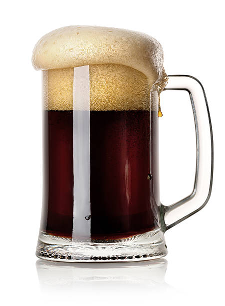 mug of black beer - dark beer stock photos and pictures