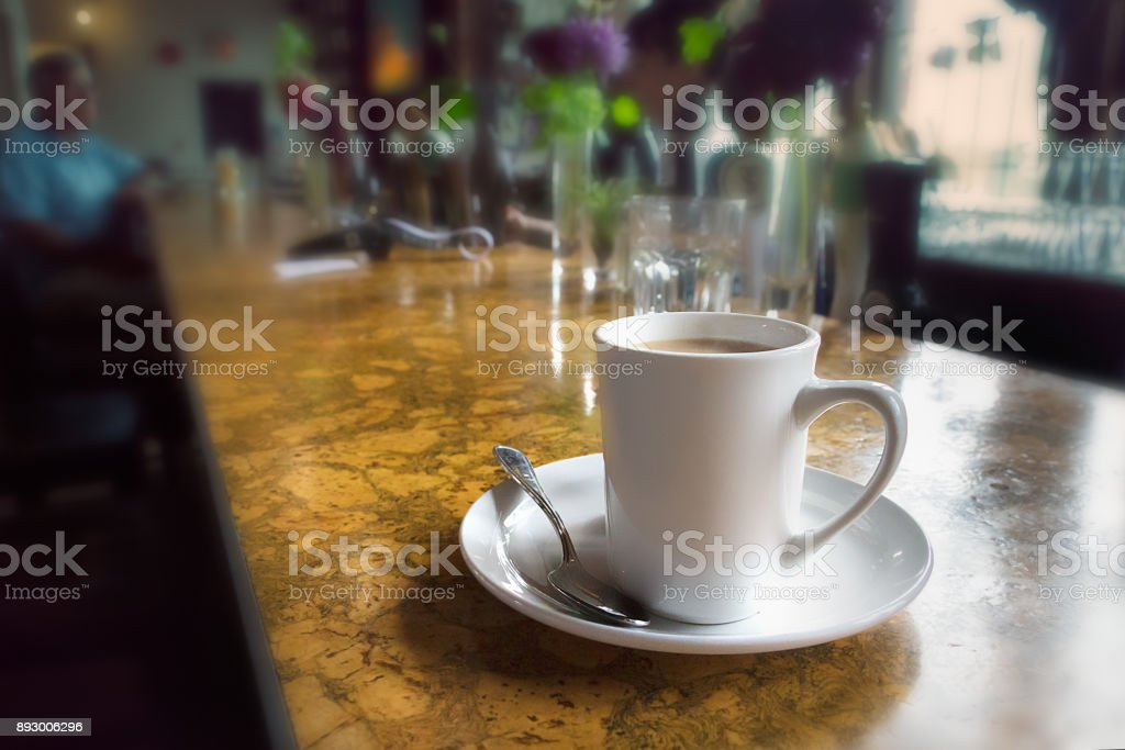 A mug of coffee on a counter bar table. stock photo