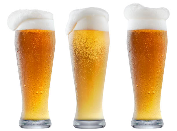 Mug of frosty beer with foam stock photo