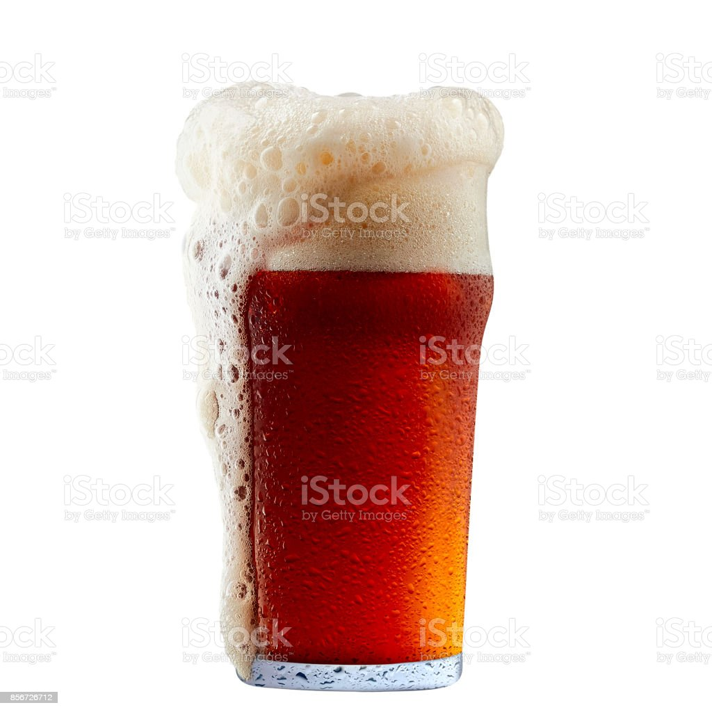 Mug of frosty dark red beer with foam stock photo