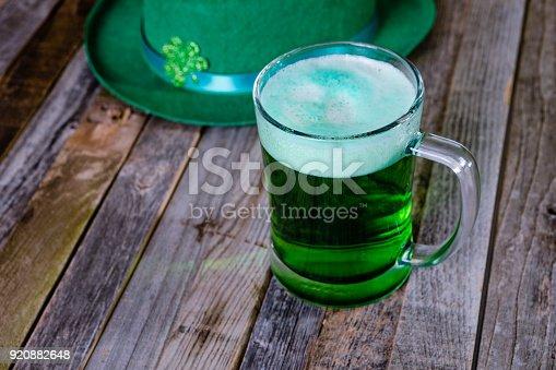 1124676977 istock photo Mug of green beer with Irish festive hat 920882648