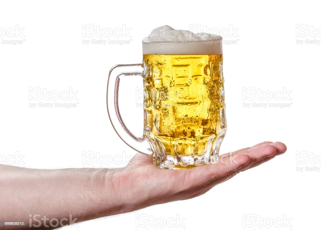 A mug of light beer in his hand. stock photo
