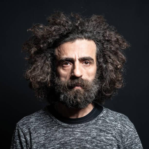 Mug Shot Of Mature Adult Man With Long Hair And Beard stock photo