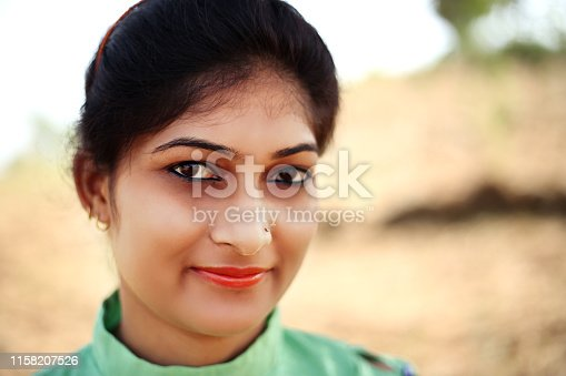 Close-Up portrait of young Indian girl and she looking at camera.