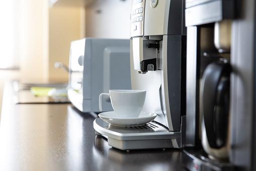 Mug stands in a coffee machine