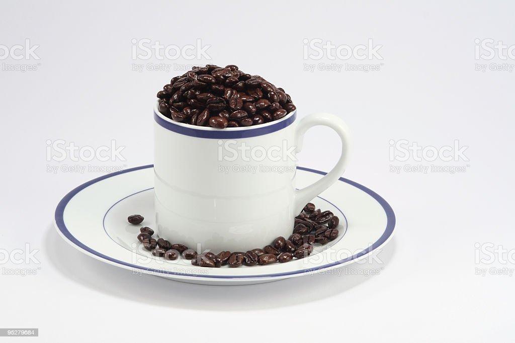 Mug With Coffee Beans royalty-free stock photo