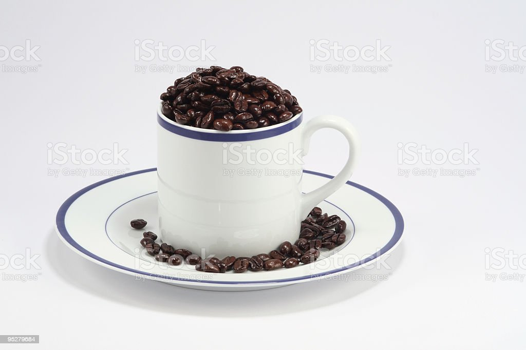 Mug With Coffee Beans stock photo