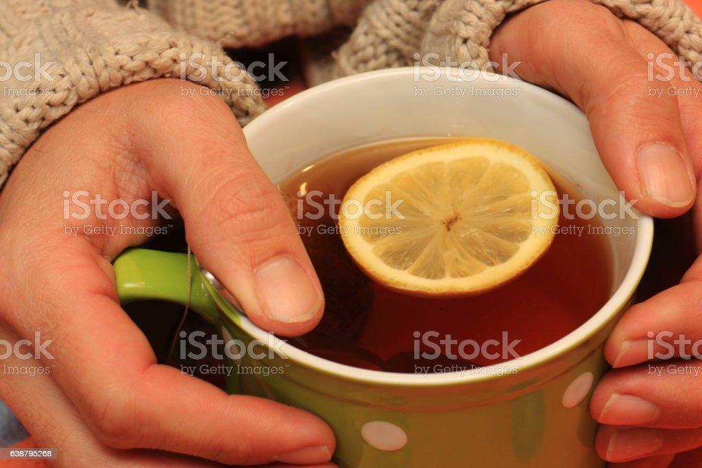 Mug with tea and lemon stock photo