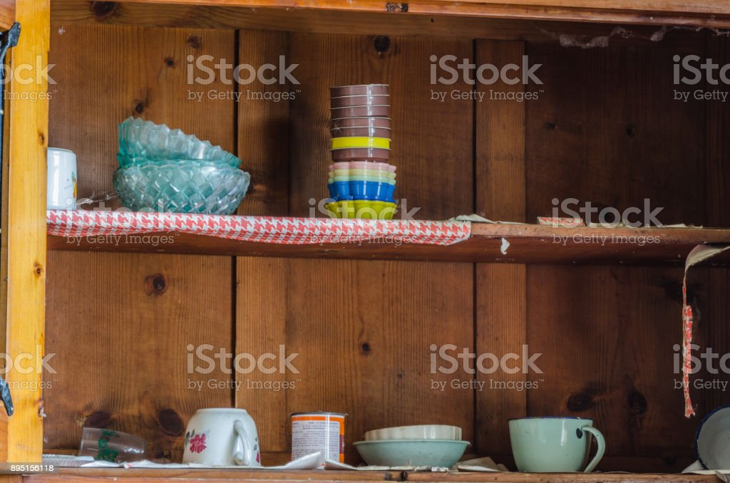 old mugs and cups in a shelf