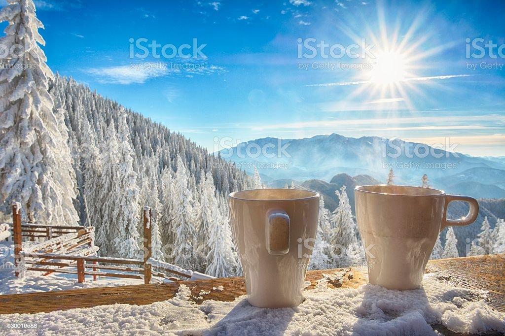 mugs and winter landscape stock photo