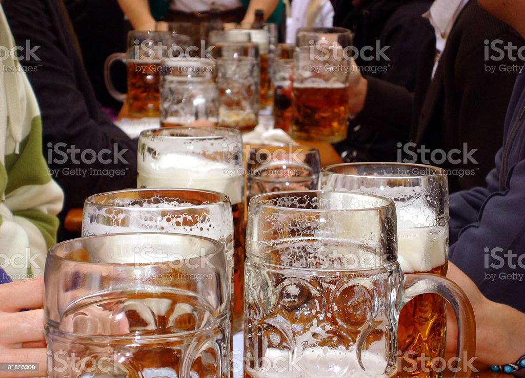 Mugs of beer at Oktoberfest in Munich, Germany stock photo