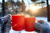 istock mugs of hot drink on sunny day 1186187365