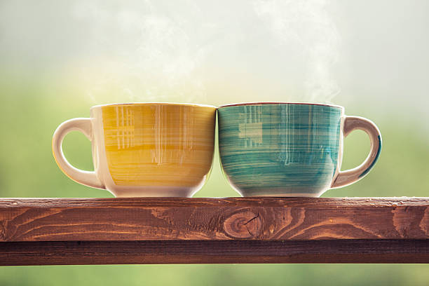 Mugs with a hot drink with tea on a wooden stock photo