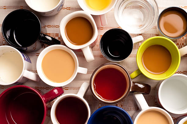 mugs with drinks Top view of a few cups of beverages caffeine stock pictures, royalty-free photos & images