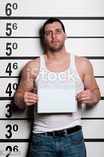 A mugshot/booking photo of a man.