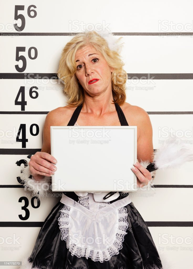 Mugshot of a Woman Wearing French Maid Outfit royalty-free stock photo