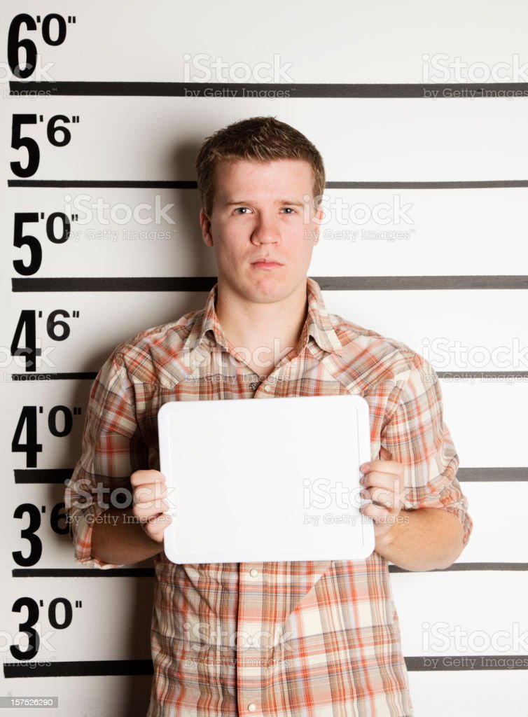 Mugshot of a Young Man stock photo