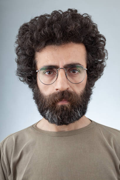 Mugshot Of Adult Man With Long Curly Hair And Beard stock photo