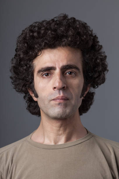 Mugshot Of Adult Man With Long Curly Hair stock photo